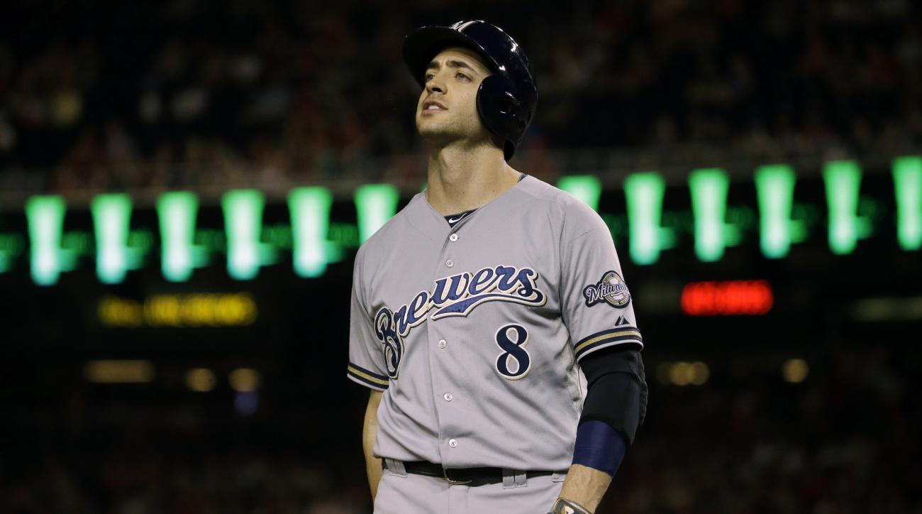 Milwaukee Brewers' Ryan Braun (8) reacts after striking out while batting against the Washington Nationals during a baseball game at Nationals Park in Washington, Saturday, Aug. 22, 2015. (AP Photo/Jacquelyn Martin)