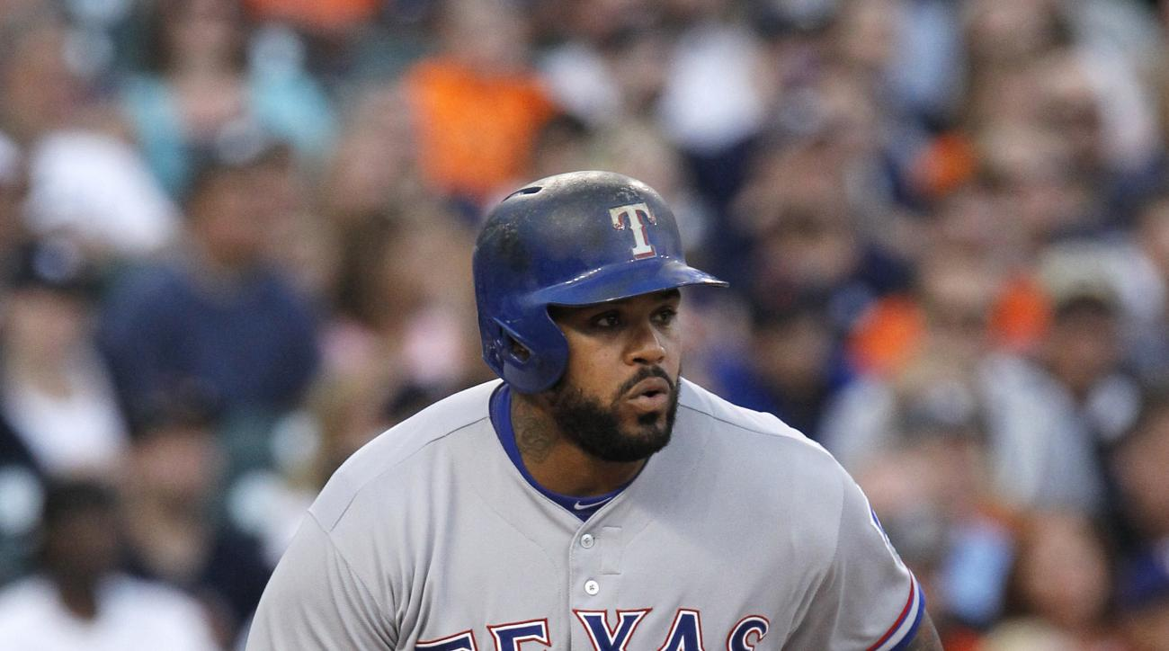 Texas Rangers' Prince Fielder singles against the Detroit Tigers to drive in Delino DeShields during the third inning of a baseball game at Comerica Park Saturday, Aug. 22, 2015, in Detroit. (AP Photo/Duane Burleson)