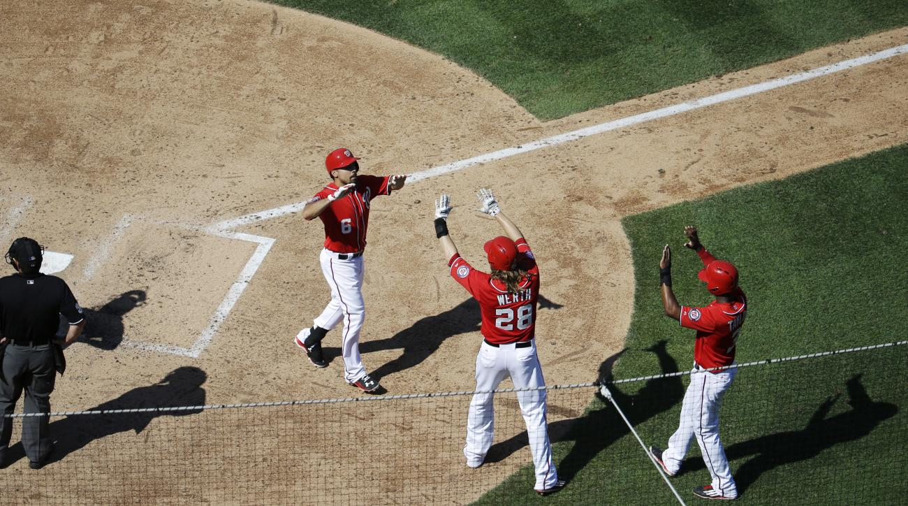 Washington Nationals' Anthony Rendon high-fives Jayson Werth (28), and Michael Taylor after Rendon's three-run home run during the fifth inning of a baseball game against the Milwaukee Brewers at Nationals Park in Washington, Sunday, Aug. 23, 2015. (AP Ph