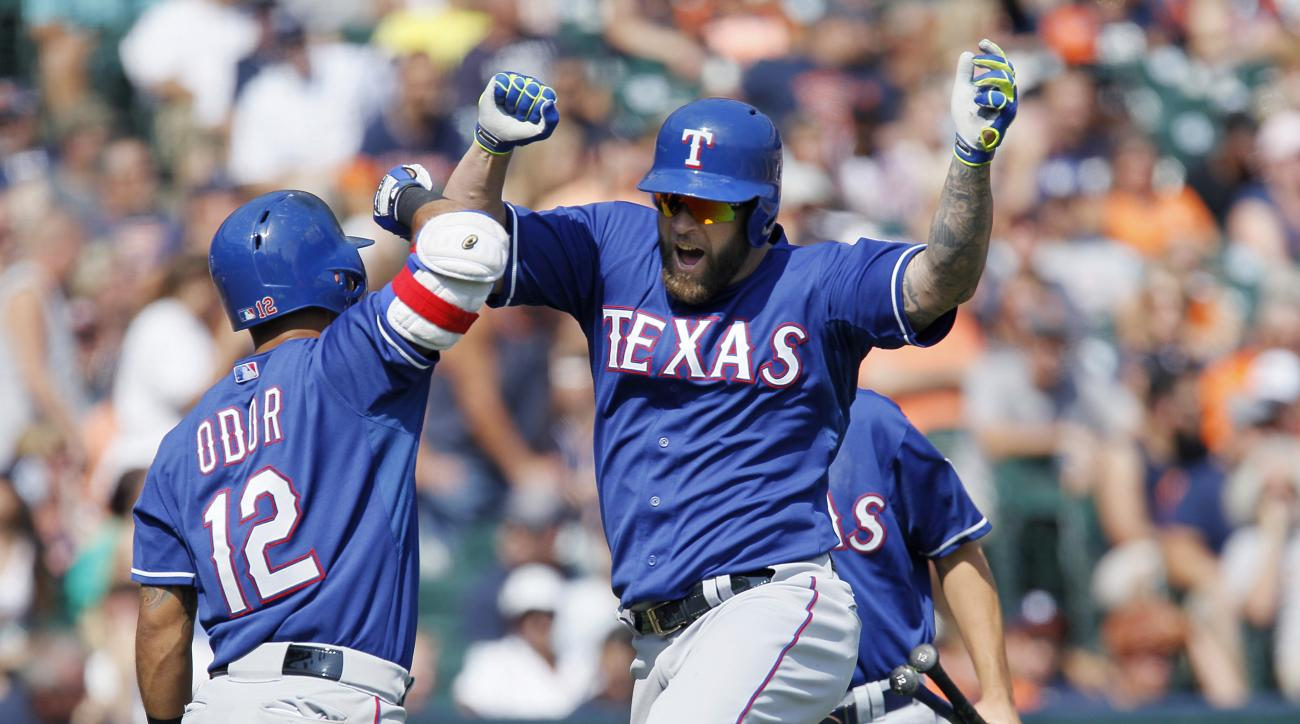 Texas Rangers' Mike Napoli celibates with Rougned Odor after hitting a solo home run against the Detroit Tigers during the eighth inning of a baseball game at Comerica Park, Sunday, Aug. 23, 2015, in Detroit. (AP Photo/Duane Burleson)