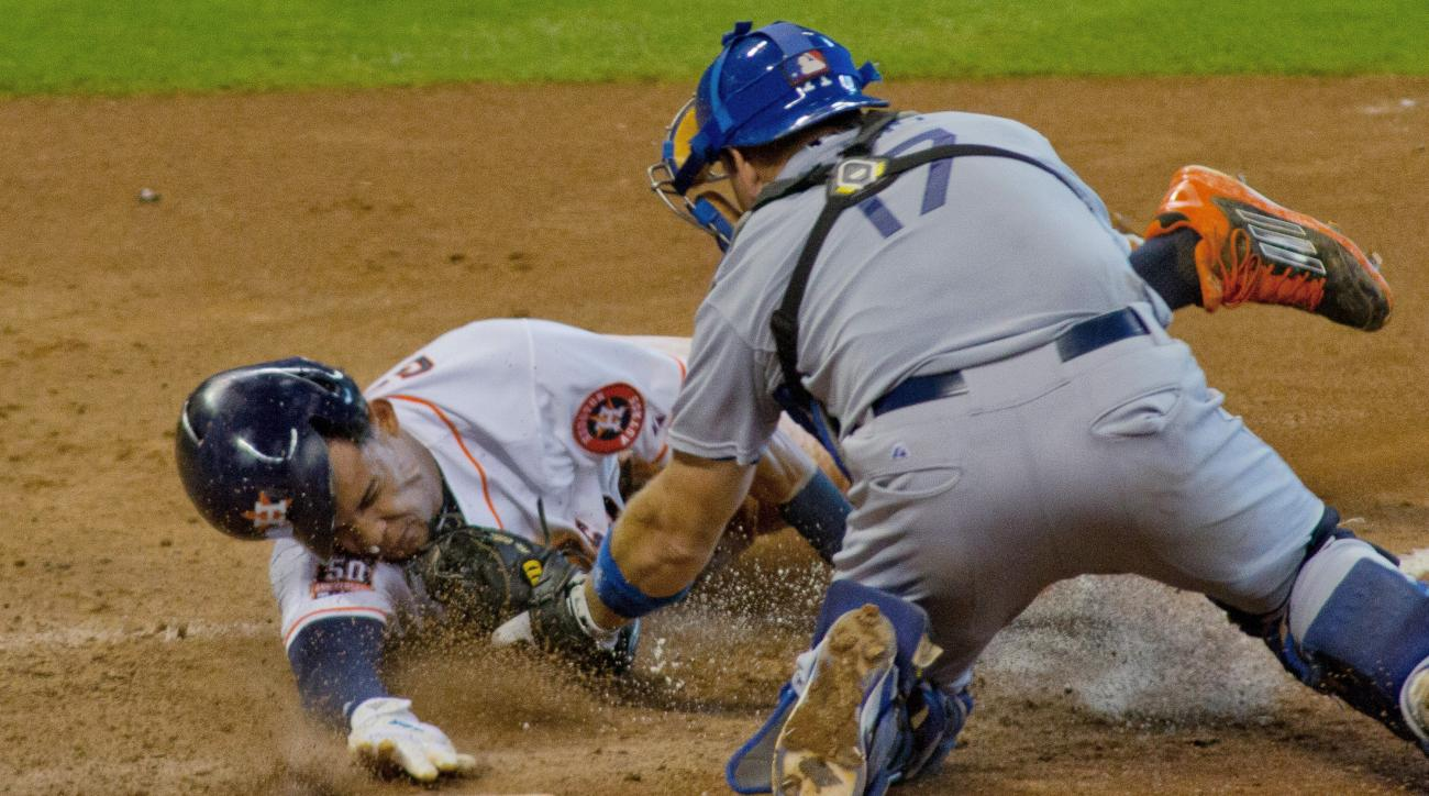 Houston Astros Carlos Gomez is caught stealing home by Los Angeles Dodgers catcher A.J. Ellis in the sixth inning of a baseball game, Sunday, Aug. 23, 2015, in Houston. (AP Photo/Richard Carson)