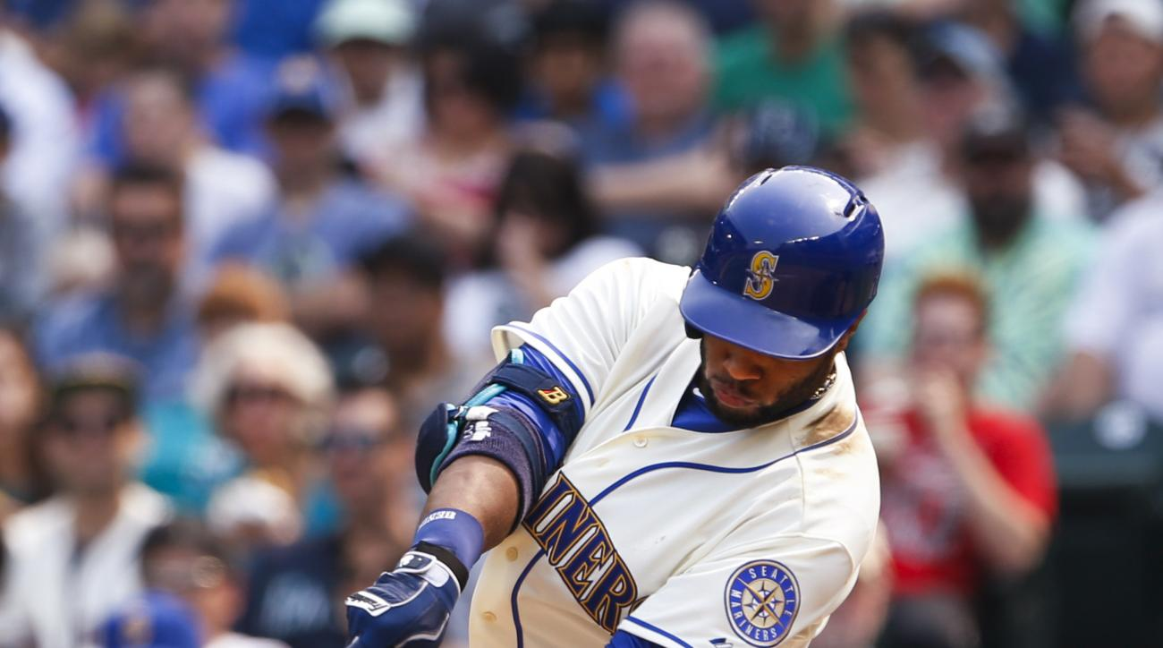 Seattle Mariners' Robinson Cano hits a two-run home run against the Chicago White Sox during the fifth inning of a baseball game Sunday, Aug. 23, 2015, in Seattle. (AP Photo/Joe Nicholson)