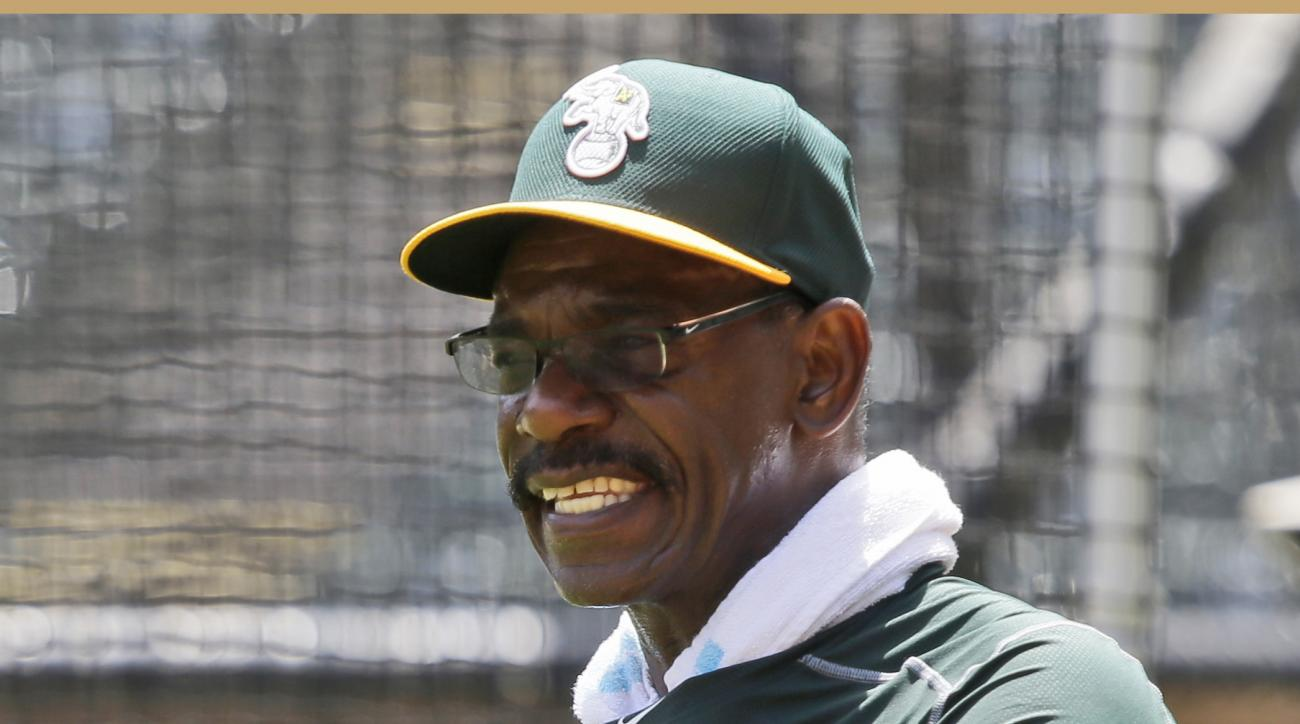 FILE - In this June 23, 2015, file photo, Oakland Athletics fielding coach Ron Washington gives instructions during a pre-batting practice workout before a baseball game against the Texas Rangers in Arlington, Texas. Washington is back in the dugout where