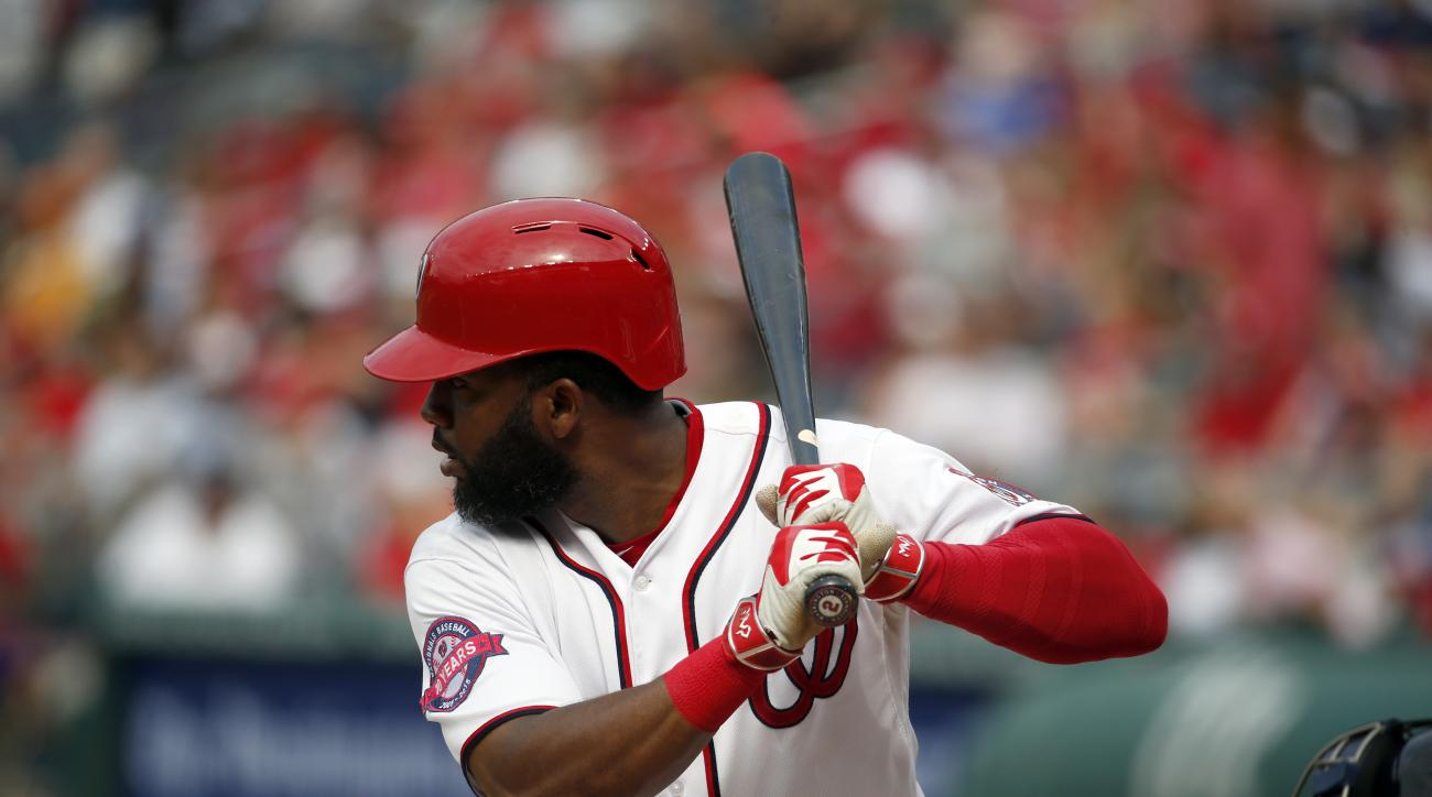 Washington Nationals center fielder Denard Span (2) bats during a baseball game against the Atlanta Braves at Nationals Park, Thursday, June 25, 2015, in Washington. (AP Photo/Alex Brandon)