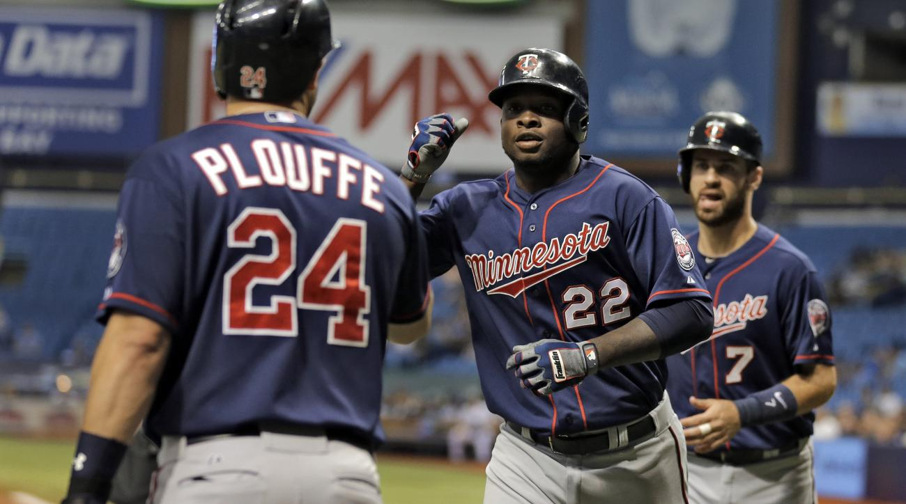 Minnesota Twins' Miguel Sano (22) high fives on-deck batter Trevor Plouffe (24) after hitting a three-run home run off Tampa Bay Rays starting pitcher Nathan Karns during the first inning of a baseball game Tuesday, Aug. 25, 2015, in St. Petersburg, Fla.B