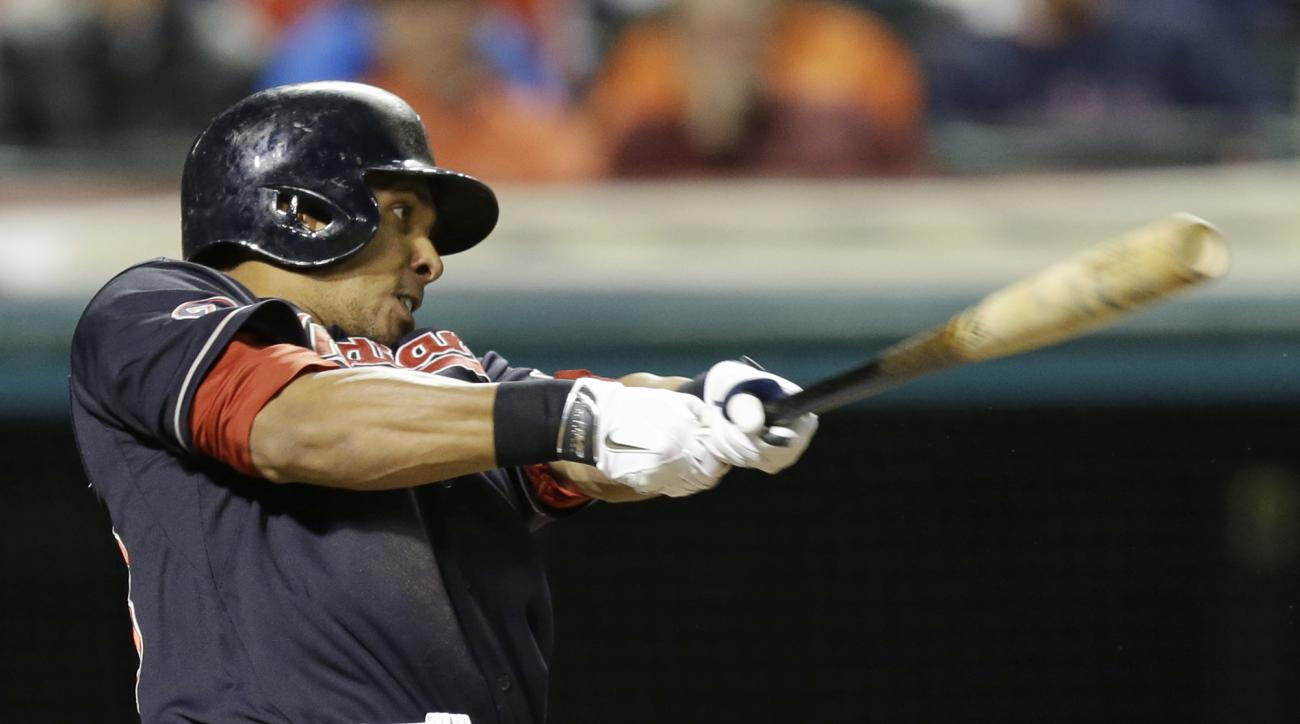 Cleveland Indians' Michael Brantley hits a two-run home run off Milwaukee Brewers starting pitcher Kyle Lohse in the fourth inning of a baseball game, Tuesday, Aug. 25, 2015, in Cleveland. Jason Kipnis scored on the play. (AP Photo/Tony Dejak)