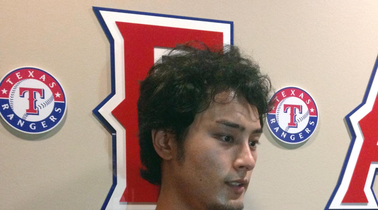 Texas Rangers' Yu Darvish, of Japan, talks with reporters outside the clubhouse before the Rangers' baseball game against the Toronto Blue Jays on Tuesday, Aug. 25, 2015, in Arlington, Texas. (AP Photo/Stephen Hawkins