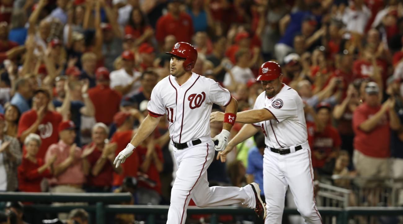 Washington Nationals' Ryan Zimmerman (11) rounds third past Nationals third base coach Bob Henley after hitting a grand slam during the sixth inning of a baseball game against the San Diego Padres at Nationals Park, Tuesday, Aug. 25, 2015, in Washington.