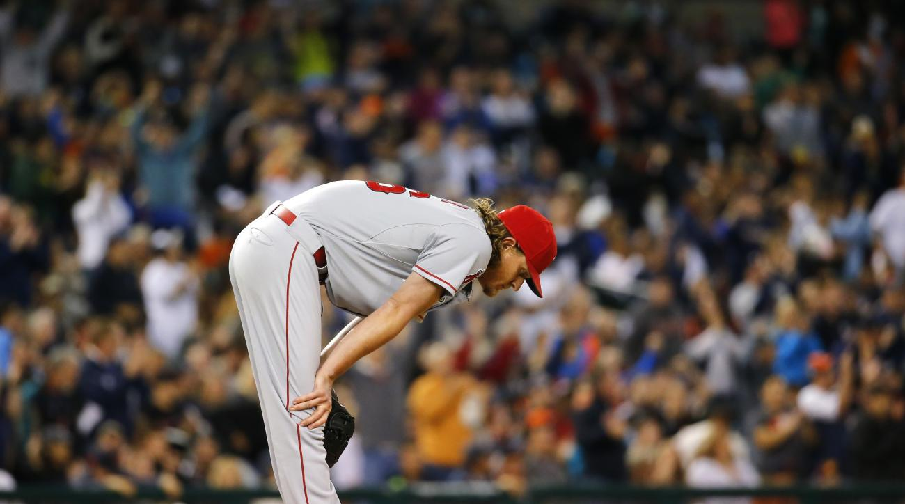 Los Angeles Angels starting pitcher Jered Weaver reacts to allowing a two-run home run by Detroit Tigers' James McCann during the sixth inning of a baseball game Tuesday, Aug. 25, 2015, in Detroit. (AP Photo/Paul Sancya)