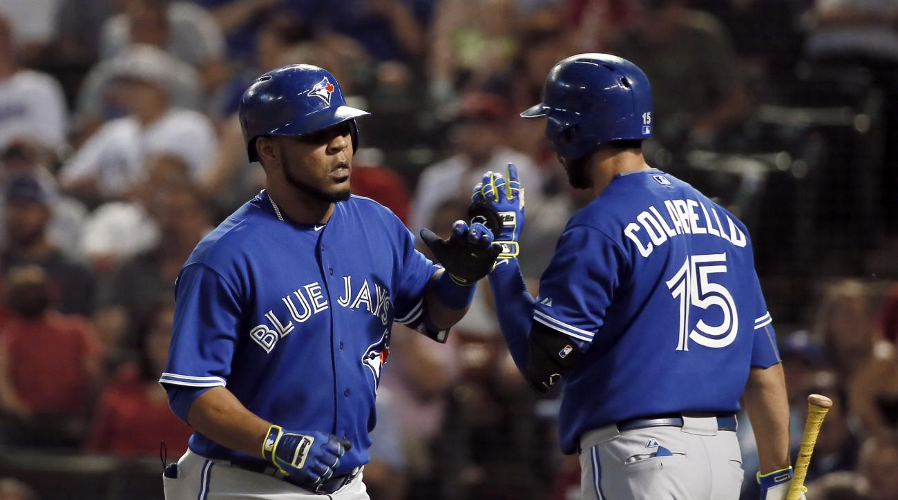 Toronto Blue Jays' Edwin Encarnacion, left, is congratulated by Chris Colabello (15) on his solo home run off of Texas Rangers' Derek Holland during the sixth inning of a baseball game Tuesday, Aug. 25, 2015, in Arlington, Texas. (AP Photo/Tony Gutierrez)