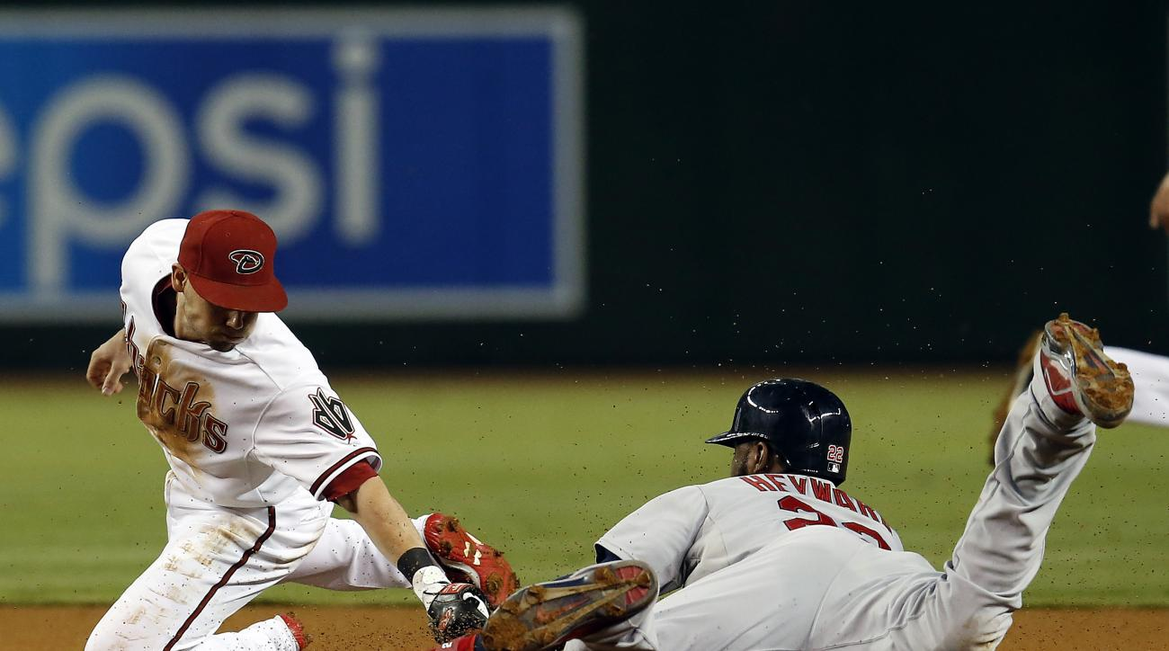 St. Louis Cardinals' Jason Heyward, right, steals second base in front of Arizona Diamondbacks second baseman Chris Owings in the first inning during a baseball game, Tuesday, Aug. 25, 2015, in Phoenix. (AP Photo/Rick Scuteri)