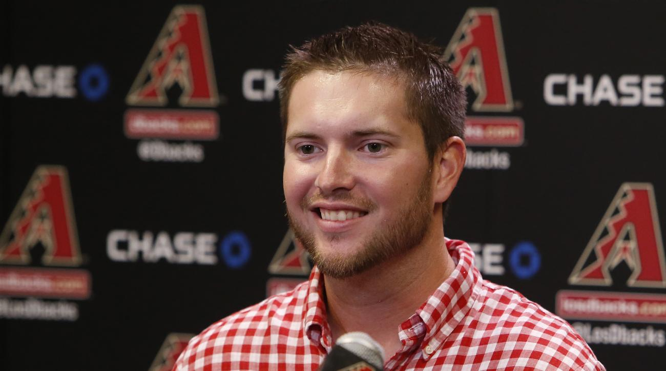 Arizona Diamondbacks' Evan Marshall talks to the media before a a baseball game against the St. Louis Cardinals, Tuesday, Aug. 25, 2015, in Phoenix. Marshall returned for the first time since taking a line drive to the head earlier this month playing for