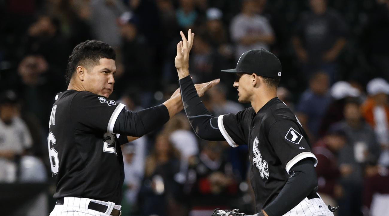 Chicago White Sox designated hitter Avisail Garcia, left, celebrates with right fielder Trayce Thompson the White Sox's 5-4 win over the Boston Red Sox in a baseball game Tuesday, Aug. 25, 2015, in Chicago. (AP Photo/Charles Rex Arbogast)