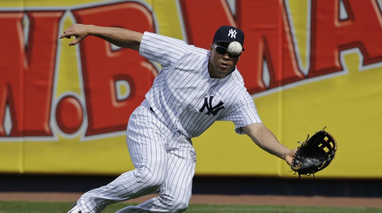 New York Yankees' Carlos Beltran catches a ball hit by Houston Astros' Jed Lowrie (8) for an out during the seventh inning of a baseball game Wednesday, Aug. 26, 2015, in New York. (AP Photo/Frank Franklin II)
