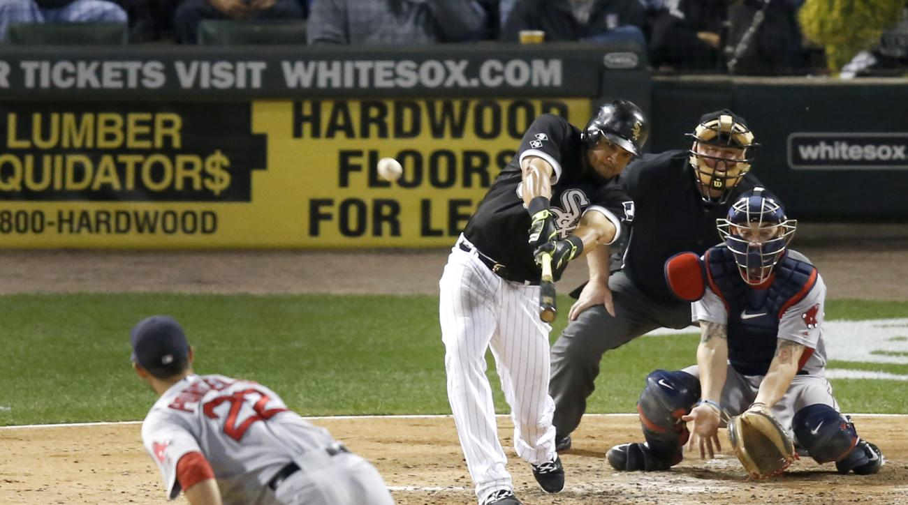 Chicago White Sox's Melky Cabrera, upper left, hits a double off Boston Red Sox starting pitcher Rick Porcello, lower left, as catcher Blake Swihart, upper right, and home plate umpire Bill Miller watch during the fourth inning of a baseball game Wednesda