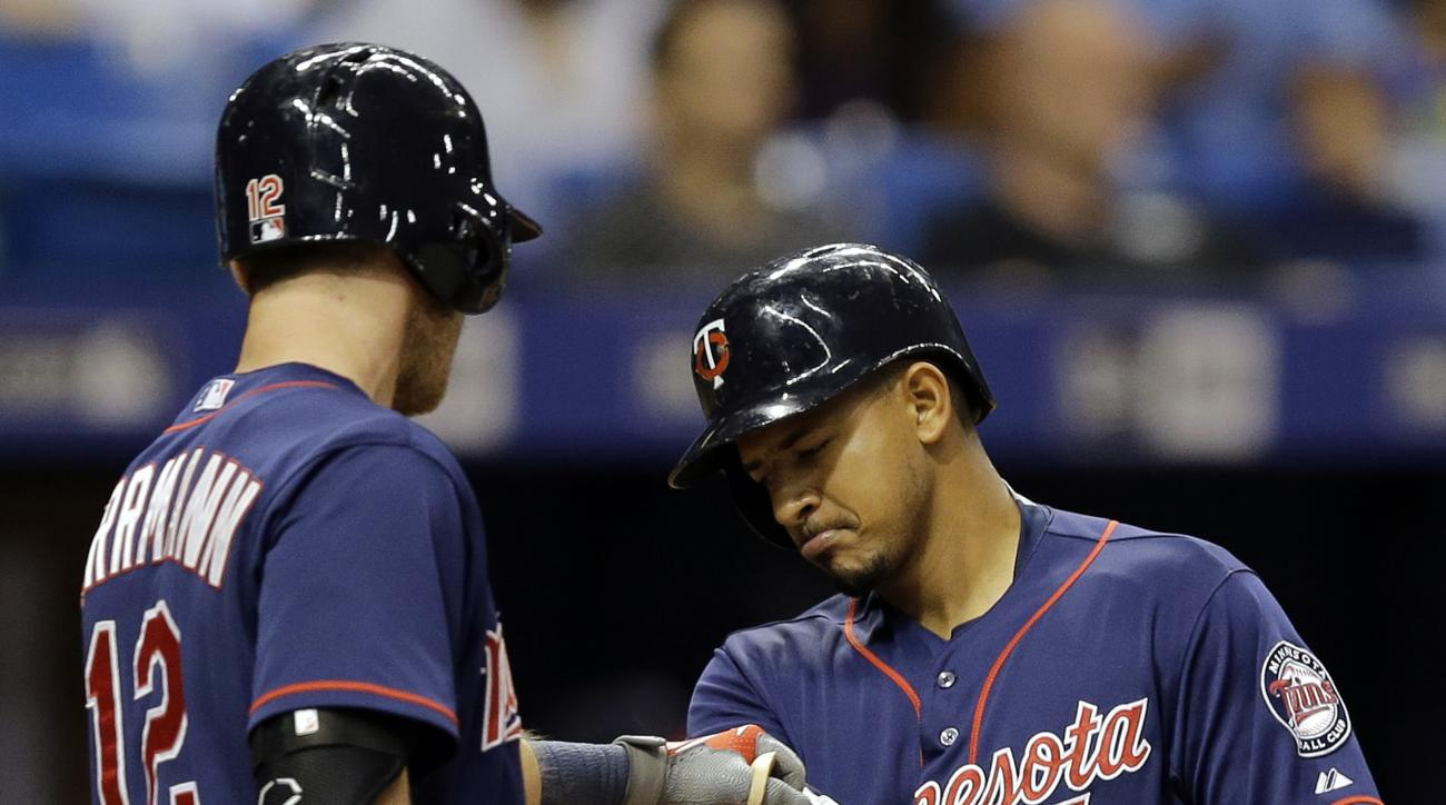 Minnesota Twins' Eduardo Escobar, right, celebrates with on-deck batter Chris Herrmann after his home run off Tampa Bay Rays relief pitcher Brandon Gomes during the eighth inning of a baseball game Wednesday, Aug. 26, 2015, in St. Petersburg, Fla.  (AP Ph