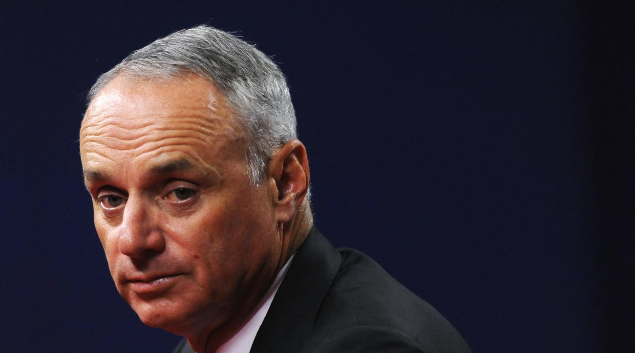 Major League Baseball Commissioner Rob Manfred talks to members of the media during a news conference, Thursday, Aug. 27, 2015, in Philadelphia. (AP Photo/Michael Perez)