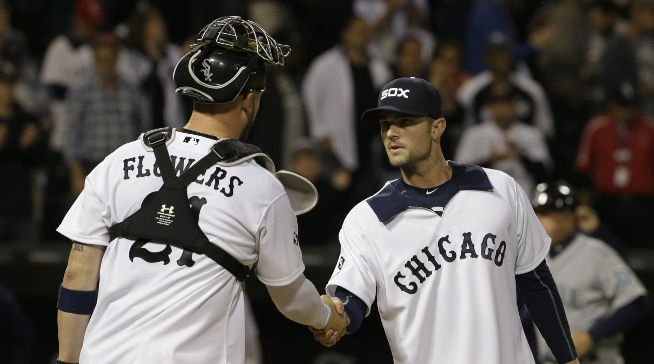 Chicago White Sox closer David Robertson, right, celebrates with catcher Tyler Flowers after they defeated the Seattle Mariners 4-2 in a baseball game Thursday, Aug. 27, 2015, in Chicago. The White Sox won 4-2. (AP Photo/Nam Y. Huh)