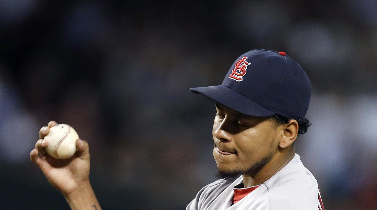 St. Louis Cardinals' Carlos Martinez paces around on the mound after giving up a two-run single to Arizona Diamondbacks' Ender Inciarte during the second inning of a baseball game Wednesday, Aug. 27, 2015, in Phoenix. (AP Photo/Ross D. Franklin)