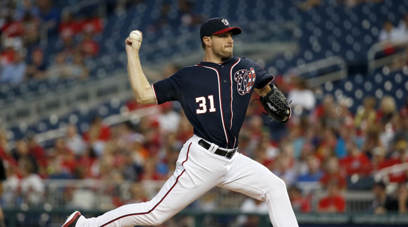 Washington Nationals starting pitcher Max Scherzer throws during the third inning of a baseball game against the Miami Marlins at Nationals Park, Friday, Aug. 28, 2015, in Washington. (AP Photo/Alex Brandon)