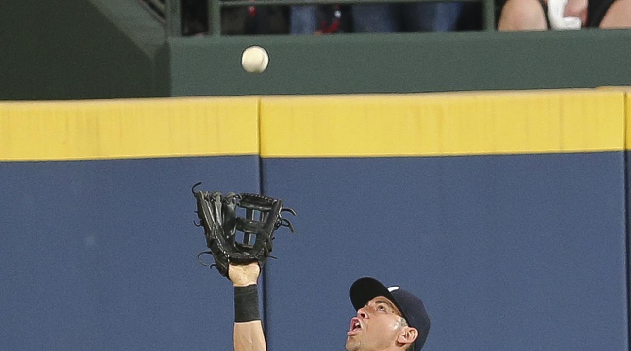 New York Yankees center fielder Jacoby Ellsbury makes a catch to retire Atlanta Braves' Christian Bethancourt in the first inning of a baseball game Friday, Aug. 28, 2015, in Atlanta. (AP Photo/John Bazemore)