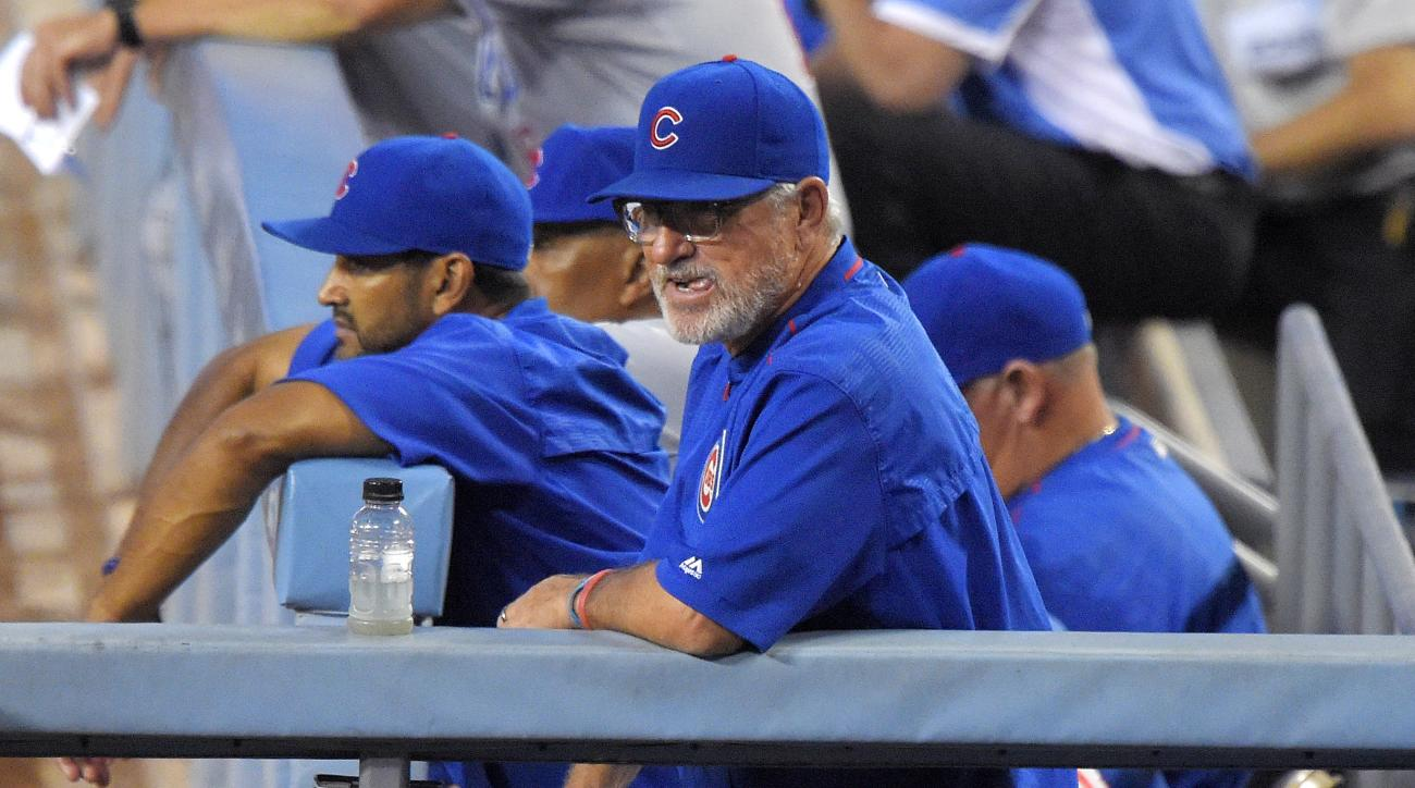 Chicago Cubs manager Joe Maddon watches from the dugout during the second inning of a baseball game against the Los Angeles Dodgers, Friday, Aug. 28, 2015, in Los Angeles. (AP Photo/Mark J. Terrill)