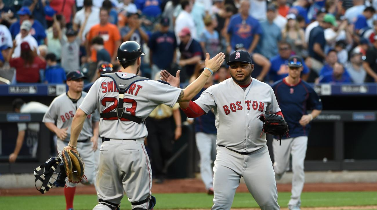 Boston Red Sox catcher Blake Swihart (23) congratulates relief pitcher Jean Machi after they defeated the New York Mets 3-1 in a baseball game at Citi Field on Saturday, Aug. 29, 2015, in New York.  (AP Photo/Kathy Kmonicek)