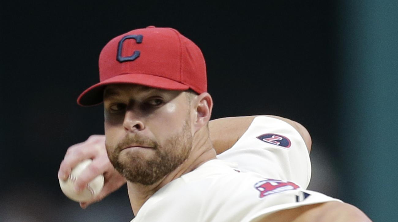 Cleveland Indians starting pitcher Corey Kluber delivers in the first inning of a baseball game against the Los Angeles Angels, Saturday, Aug. 29, 2015, in Cleveland. (AP Photo/Tony Dejak)