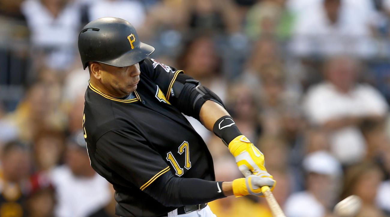 Pittsburgh Pirates' Aramis Ramirez hits a three-run home run during the first inning of a baseball game against the Colorado Rockies, Saturday, Aug. 29, 2015, in Pittsburgh. (AP Photo/Keith Srakocic)