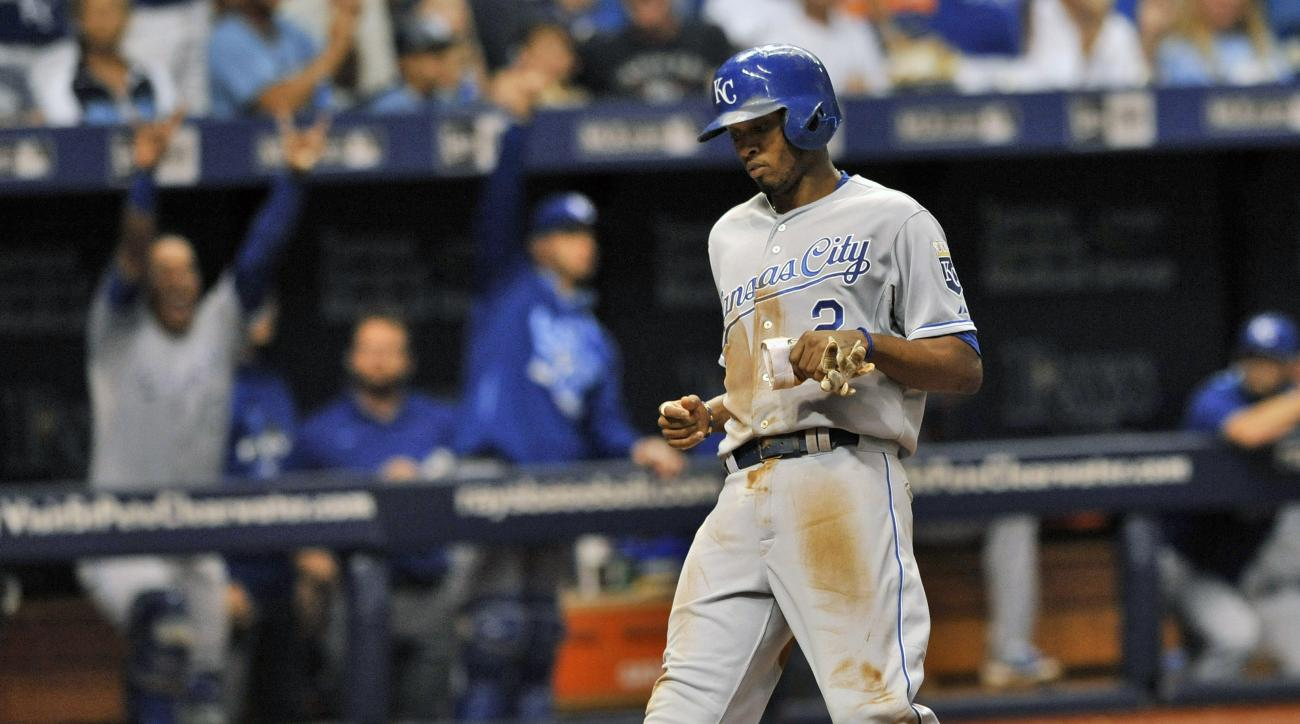 Kansas City Royals' Alcides Escobar (2) scores on a single hit by Lorenzo Cain off Tampa Bay Rays reliever Steve Geltz during the sixth inning of a baseball game Saturday, Aug. 29, 2015, in St. Petersburg, Fla. (AP Photo/Steve Nesius)