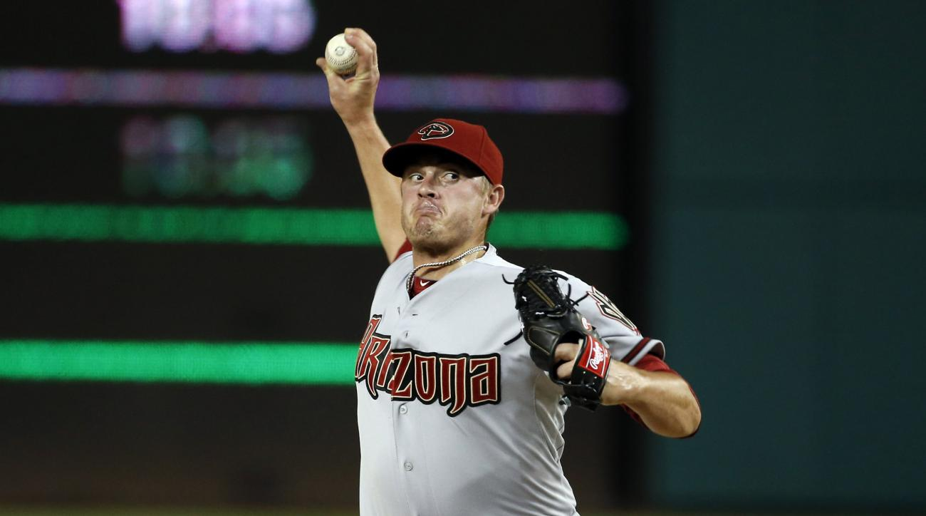 FILE - In this Monday, Aug. 3, 2015 file photo, Arizona Diamondbacks relief pitcher Addison Reed (43) throws during a baseball game against the Washington Nationals at Nationals Park in Washington. A person familiar with the deal says the New York Mets an