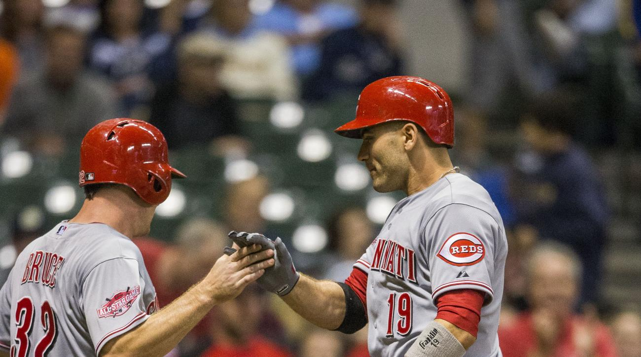 Cincinnati Reds' Joey Votto, right, and Jay Bruce react after Votto hit a two-run home run off Milwaukee Brewers' Francisco Rodriguez during the ninth inning of a baseball game Saturday, Aug. 29, 2015, in Milwaukee. (AP Photo/Tom Lynn)