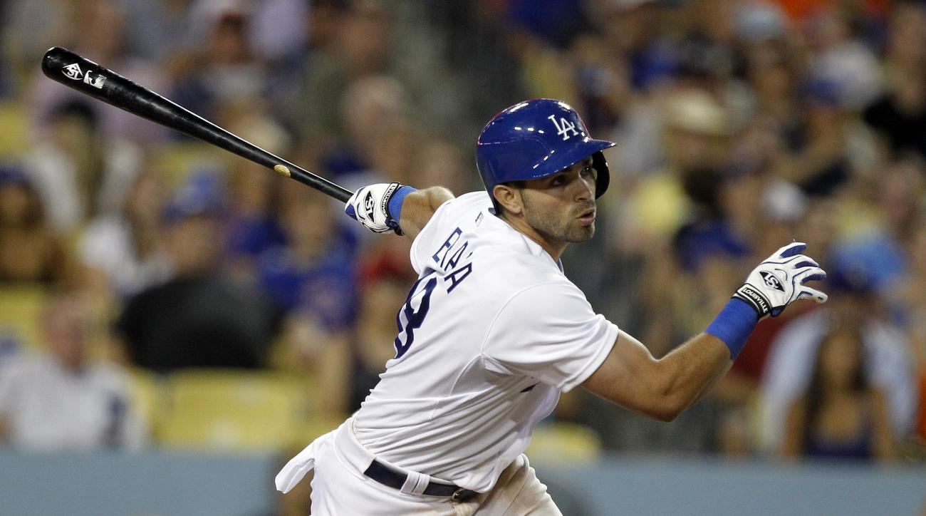 Los Angeles Dodgers' Jose Peraza hits a double to score Carl Crawford during the seventh inning of a baseball game against the Chicago Cubs in Los Angeles, Saturday, Aug. 29, 2015. (AP Photo/Alex Gallardo)