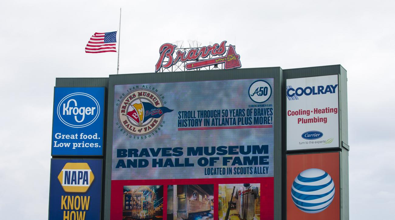 A United States flag flies at half-staff prior to a baseball game between the New York Yankees and the Atlanta Braves, Sunday, Aug. 30, 2015, in Atlanta. (AP Photo/Todd Kirkland)