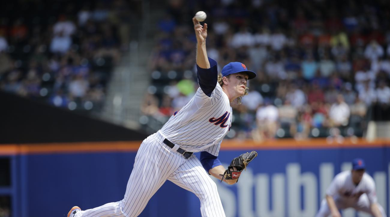 New York Mets starting pitcher Noah Syndergaard delivers in the first inning of an interleague baseball game against the Boston Red Sox in New York, Sunday, Aug. 30, 2015. (AP Photo/Kathy Willens)