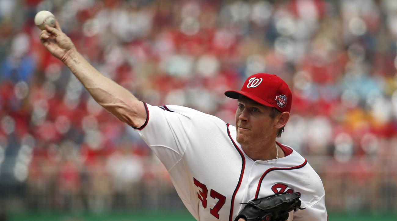 Washington Nationals starting pitcher Stephen Strasburg throws during the first inning of a baseball game against the Miami Marlins at Nationals Park, Sunday, Aug. 30, 2015, in Washington. (AP Photo/Alex Brandon)