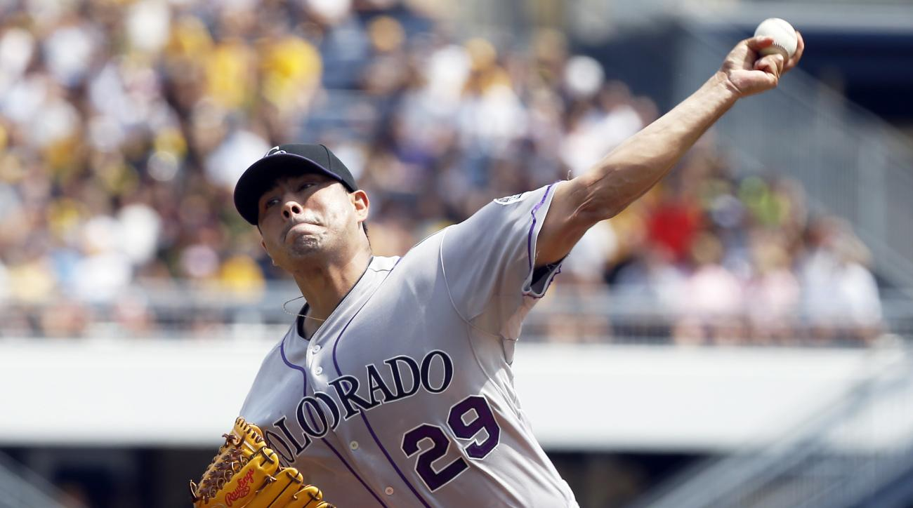 Colorado Rockies starter Jorge De La Rosa pitches against the Pittsburgh Pirates in the first inning of a baseball game, Sunday, Aug. 30, 2015, in Pittsburgh. (AP Photo/Keith Srakocic)