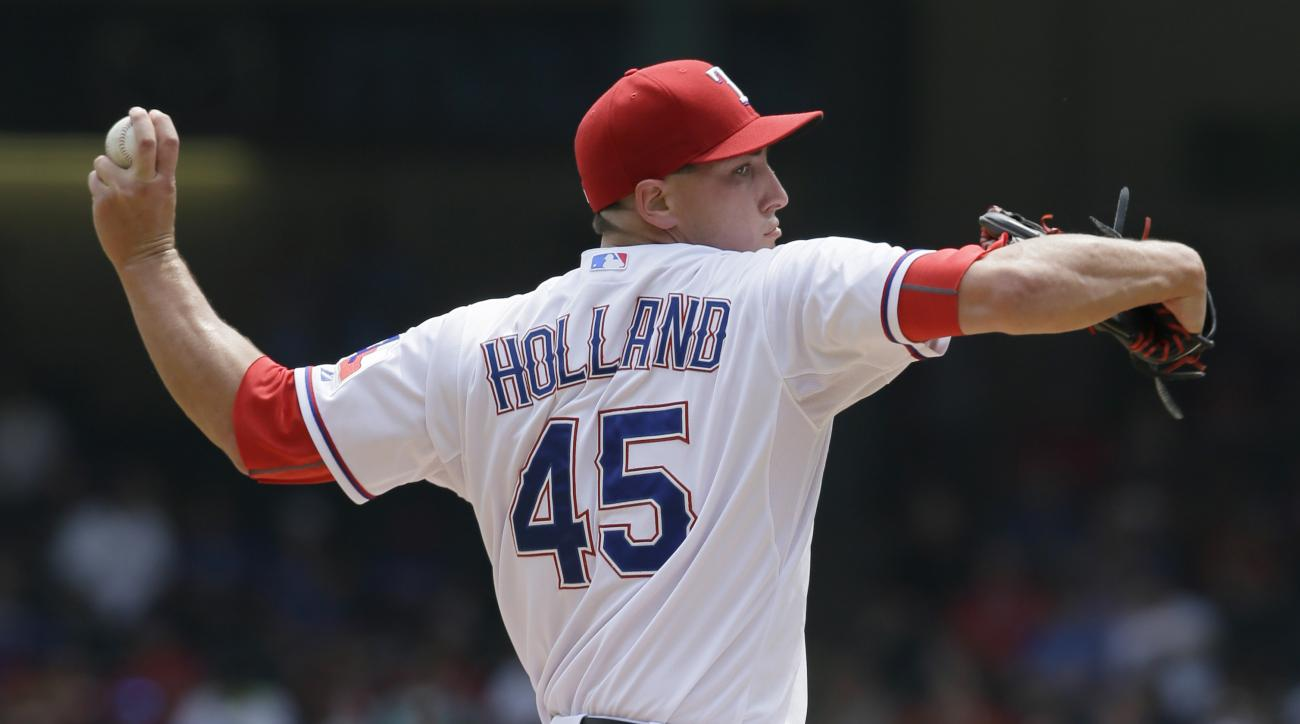 Texas Rangers starting pitcher Derek Holland throws during the first inning of a baseball game against the Baltimore Orioles in Arlington, Texas, Sunday, Aug. 30, 2015. (AP Photo/LM Otero)