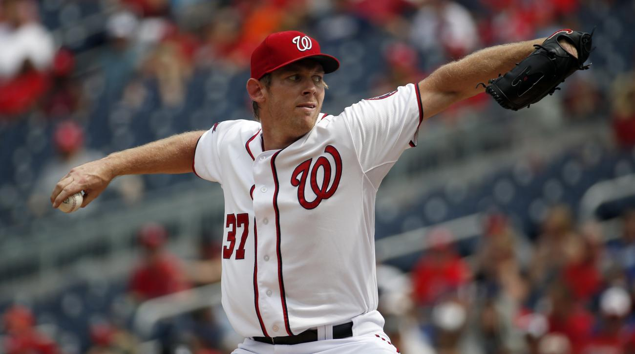 Washington Nationals starting pitcher Stephen Strasburg throws during the third inning of a baseball game against the Washington Nationals at Nationals Park, Sunday, Aug. 30, 2015, in Washington.  (AP Photo/Alex Brandon)