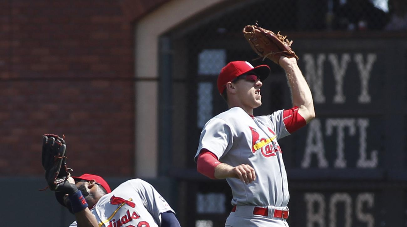 St. Louis Cardinals' Stephen Piscotty, right, catches a fly ball hit by San Francisco Giants' Matt Duffy during the third inning of a baseball game, Sunday, Aug. 30, 2015, in San Francisco. At left is Cardinals' Jason Heyward. (AP Photo/George Nikitin)