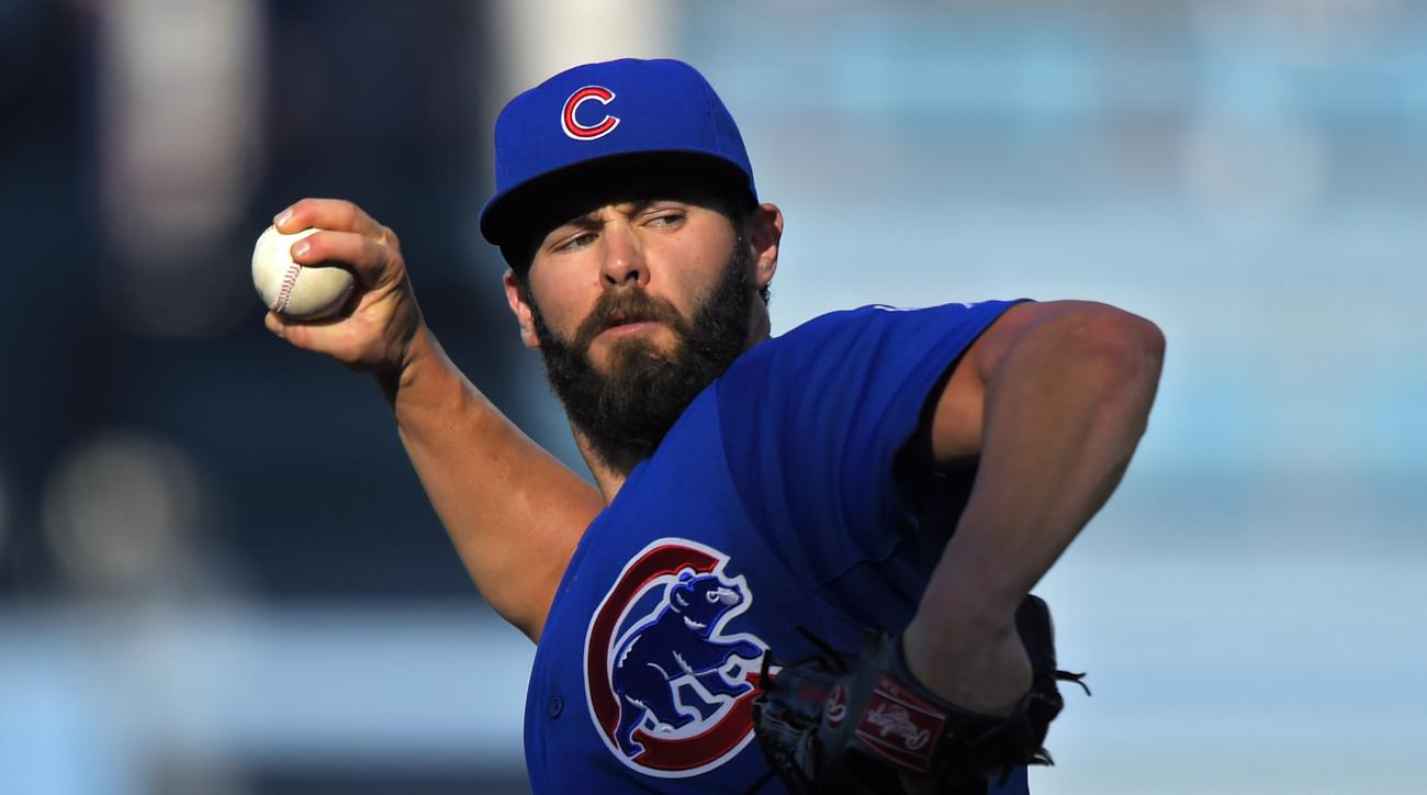 Chicago Cubs starting pitcher Jake Arrieta throws to the plate during the first inning of a baseball game against the Los Angeles Dodgers, Sunday, Aug. 30, 2015, in Los Angeles. (AP Photo/Mark J. Terrill)