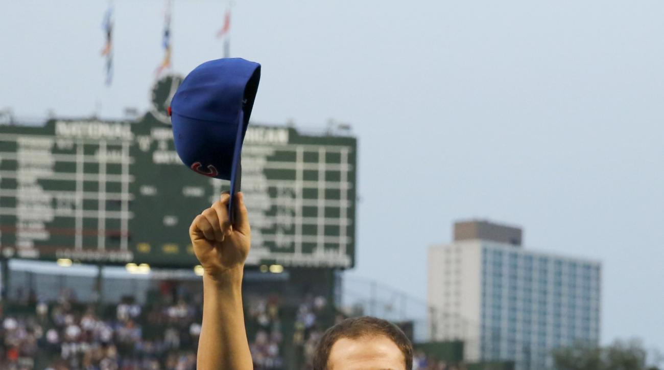 Chicago Cubs pitcher Jake Arrieta acknowledges the crowd as he is honored at Wrigley Field for his no hitter yesterday against the Los Angeles Dodgers, before a baseball game against the Cincinnati Reds Monday, Aug. 31, 2015, in Chicago. (AP Photo/Charles
