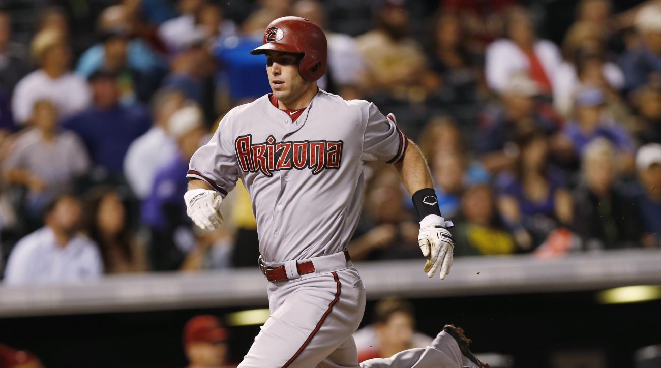 Arizona Diamondbacks' Paul Goldschmidt runs down the third base line to score on a single by David Peralta off Colorado Rockies starting pitcher Chad Bettis in the fifth inning of a baseball game Monday, Aug. 31, 2015, in Denver. (AP Photo/David Zalubowsk