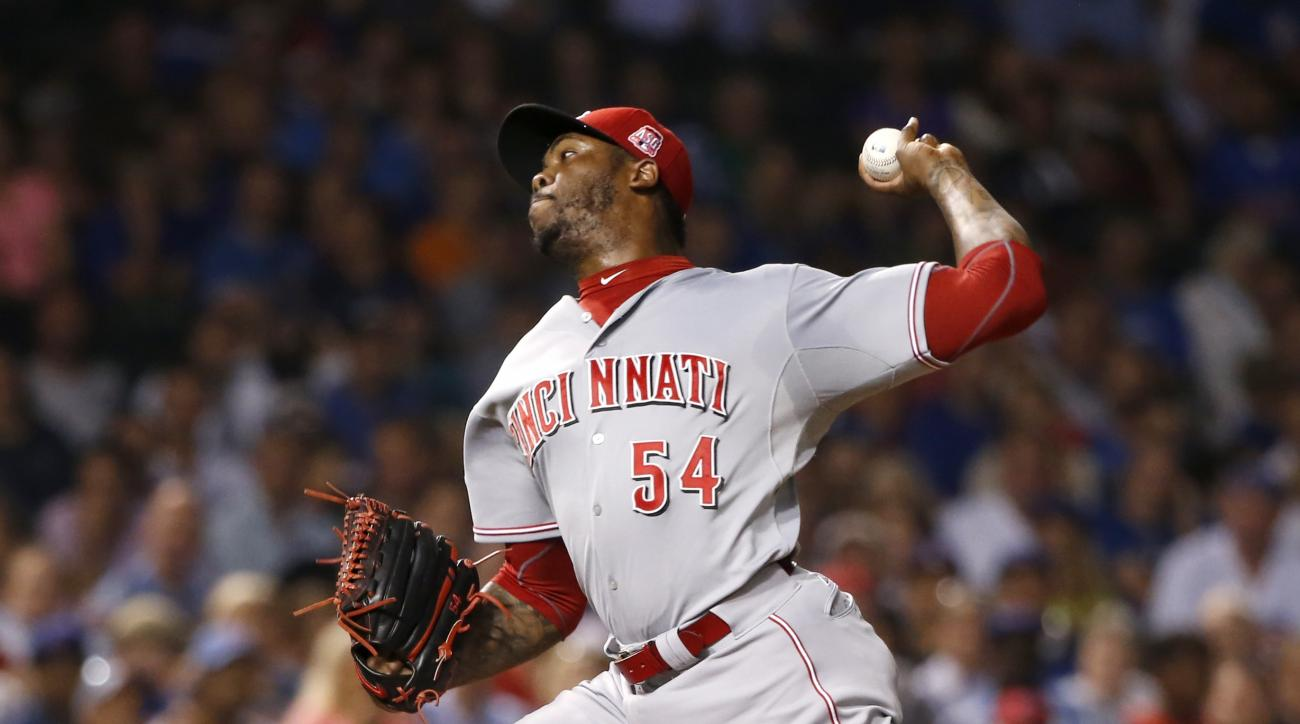 Cincinnati Reds relief pitcher Aroldis Chapman delivers during the eighth inning of a baseball game against the Chicago Cubs Monday, Aug. 31, 2015, in Chicago. (AP Photo/Charles Rex Arbogast)