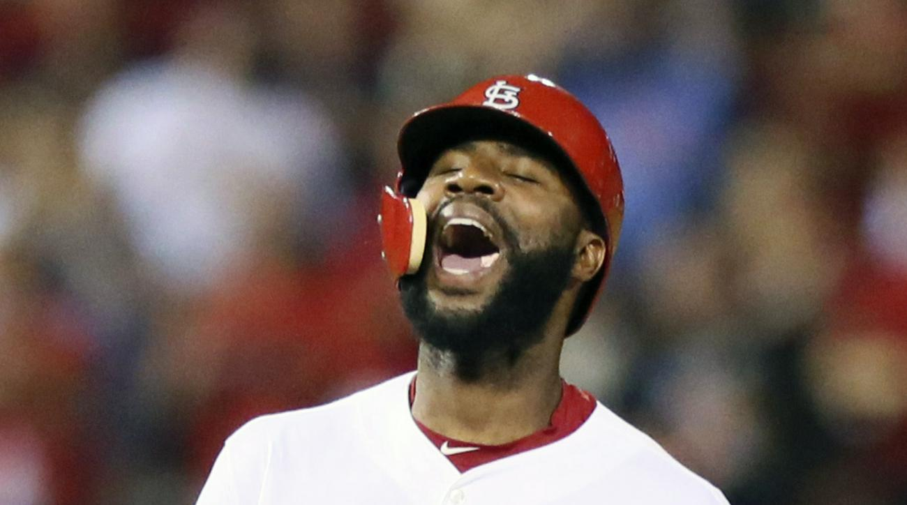 St. Louis Cardinals' Jason Heyward reacts after driving in two runs with a double during the seventh inning of a baseball game against the Washington Nationals, Monday, Aug. 31, 2015, in St. Louis. (Chris Lee/St. Louis Post-Dispatch via AP)  EDWARDSVILLE