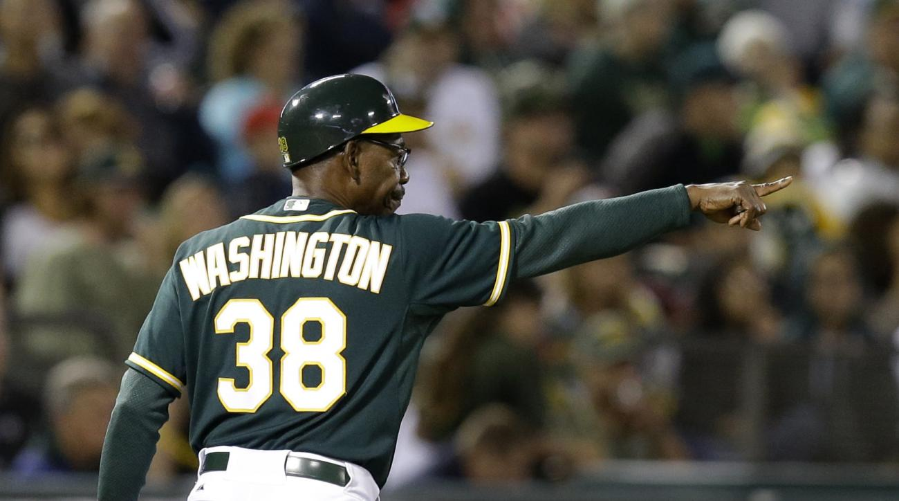 Oakland Athletics third base coach Ron Washington points in the third inning of a baseball game against the Los Angeles Angels Monday, Aug. 31, 2015, in Oakland, Calif. (AP Photo/Ben Margot)