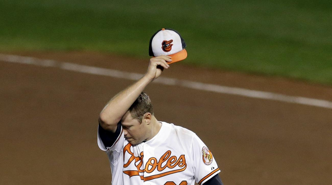Baltimore Orioles starting pitcher Chris Tillman wipes sweat from his face in the fourth inning of a baseball game against the Tampa Bay Rays, Tuesday, Sept. 1, 2015, in Baltimore. Tampa Bay scored four runs in the fourth. (AP Photo/Patrick Semansky)