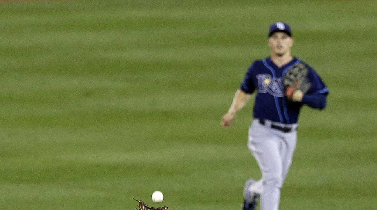 Tampa Bay Rays second baseman Logan Forsythe, bottom, catches a fly ball by Baltimore Orioles' Steve Pearce in the third inning of a baseball game, Tuesday, Sept. 1, 2015, in Baltimore. (AP Photo/Patrick Semansky)