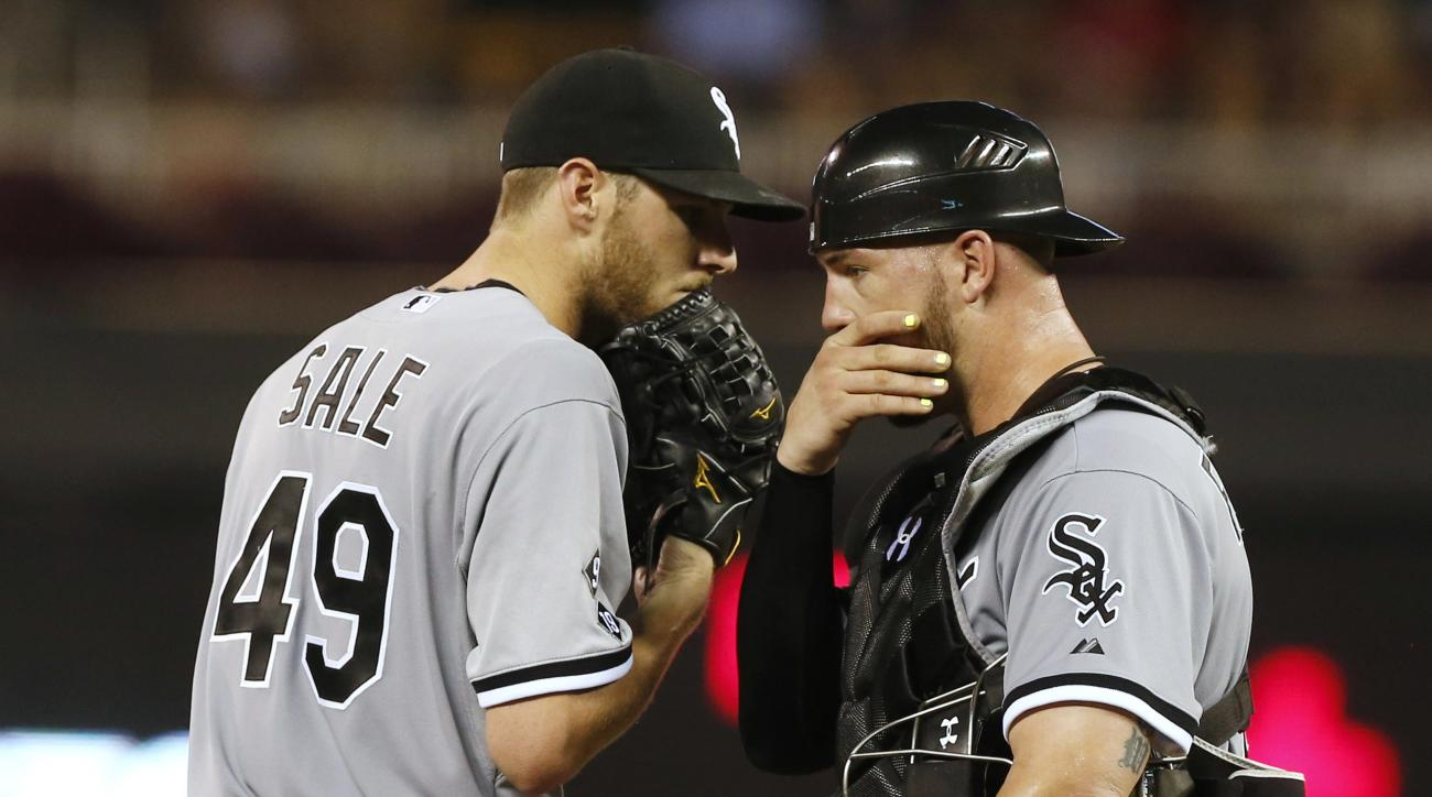 Chicago White Sox pitcher Chris Sale, left, and catcher Tyler Flowers confer during the fourth inning of a baseball game against the Minnesota Twins, Tuesday, Sept. 1, 2015, in Minneapolis. (AP Photo/Jim Mone)