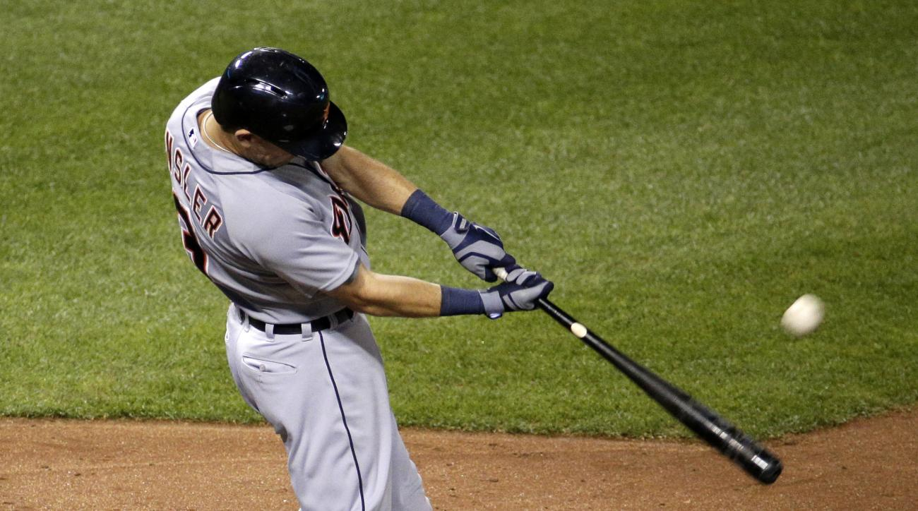 Detroit Tigers' Ian Kinsler hits a two-run home run during the seventh inning of a baseball game against the Kansas City Royals Tuesday, Sept. 1, 2015, in Kansas City, Mo. (AP Photo/Charlie Riedel)
